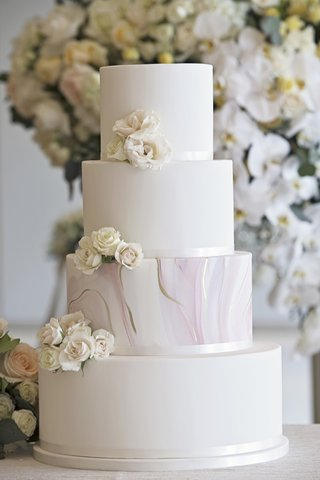 minimalist-wedding-cake-with-blush-and-gold-marble-tier-fresh-white-flowers-as-accent