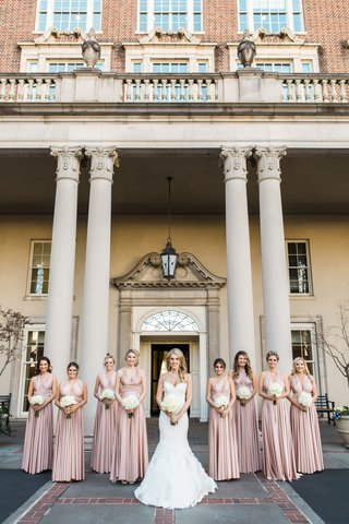 bride-in-ines-di-santo-gown-and-bridesmaids-stand-together