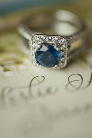 wedding-ring-round-sapphire-engagement-ring-with-halo-drop-setting-pave-diamonds-on-band