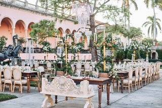 ringling-museum-wedding-reception-with-gold-candelabra-and-lots-of-greenery-courtyard-with-statues