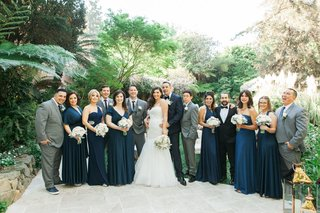 bride-and-groom-with-navy-bridesmaid-dresses-and-grey-suits-for-groomsmen-hotel-bel-air