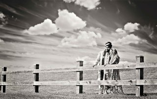 black-and-white-photo-of-indian-bride-and-groom-in-field