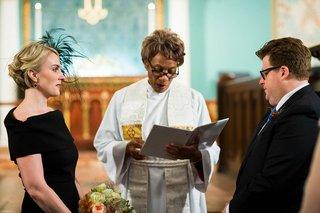 bride-in-a-black-oscar-de-la-renta-dress-groom-in-navy-suit-at-park-avenue-united-methodist-church
