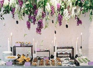 wedding-event-food-display-purple-white-wisteria-greenery-black-white-decor-appetizers