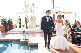 bride-in-mermaid-dress-and-groom-holding-hands