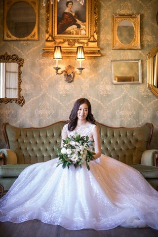 asian-bride-in-berta-ball-gown-with-sparkling-skirt-and-large-bouquet
