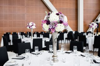 wedding-reception-tall-silver-centerpiece-with-white-hydrangea-purple-flowers-round-table-black