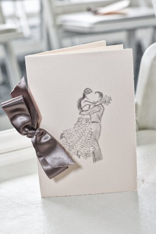 ceremony-program-with-hand-drawn-sketch-of-bride-and-groom