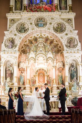 bride-and-groom-at-altar-st-michaels-church-old-town-chicago-catholic-wedding-ceremony-ornate-altar