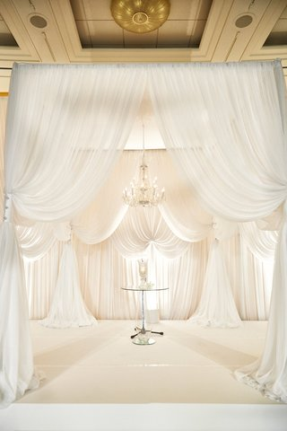 white-curtain-ceremony-arch-all-white-altar-drapery