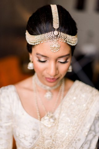 south-asian-bride-wearing-traditional-gold-headpiece-from-sri-lanka