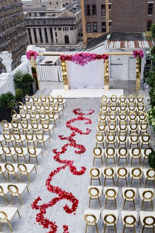 aerial-view-of-rooftop-wedding-ceremony-gold-chairs-flower-swirl-aisle-gold-archway-altar-white
