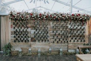 wedding-reception-fall-wedding-ideas-lanterns-reclaimed-wood-wall-burgundy-flowers