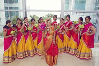 indian-wedding-bride-and-bridesmaids-in-traditional-sari-red-gold-orange-saris-fun-bridesmaids