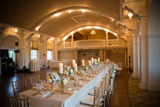 antique-style-ballroom-and-long-table-decorated-with-candles-and-flowers