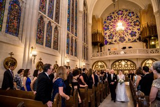 bride-in-lace-v-neck-carolina-herrera-walks-down-the-aisle-with-father-of-the-bride