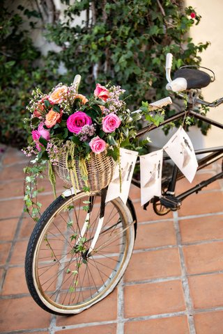 wedding-decor-terracotta-tile-old-bike-with-banner-illustration-bride-groom-pink-orange-flowers