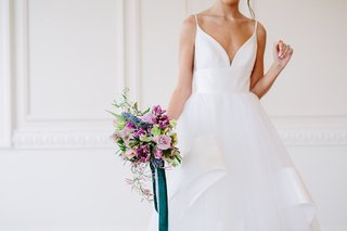 unique-bridal-bouquet-with-blue-and-purple-tied-with-forest-green-ribbon