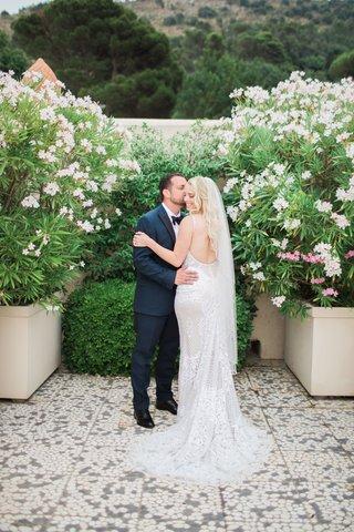 bride-in-galia-lahav-wedding-dress-with-plunging-neckline-groom-in-navy-tuxedo-capri-wedding