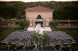wedding-ceremony-full-shot-grand-del-mar-flower-chuppah-with-flower-walls-and-initials