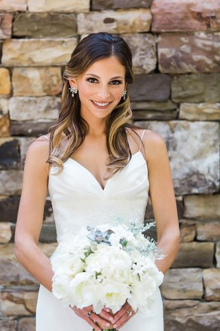 bride-in-wedding-dress-from-bella-bianca-bridal-couture-long-hair-curled-highlights-earrings