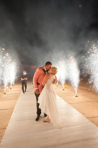 bride-in-mark-zunino-high-low-wedding-dress-groom-in-salmon-tuxedo-jacket-fireworks