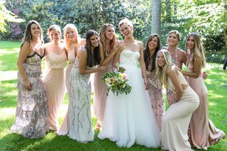 bride-in-strapless-wedding-dress-pink-green-bodice-pink-white-cream-champagne-bridesmaid-dresses