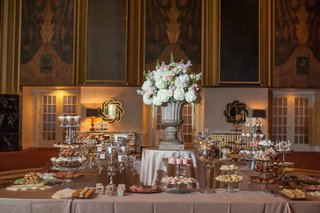 wedding-reception-cookie-table-with-cake-pop-cupcake-chocolate-mousse-macarons