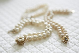 double-row-of-pearls-with-gold-floral-clasp