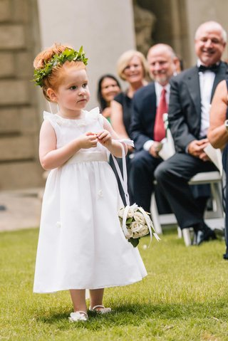 white-flower-girl-dress-pomander-ball-green-leaf-flower-crown-rosette-details-on-skirt